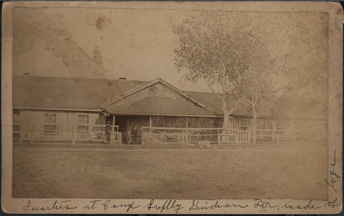 John Edmund Yard seated on the porch of his quarters at Camp Supply, Indian Territory - Page