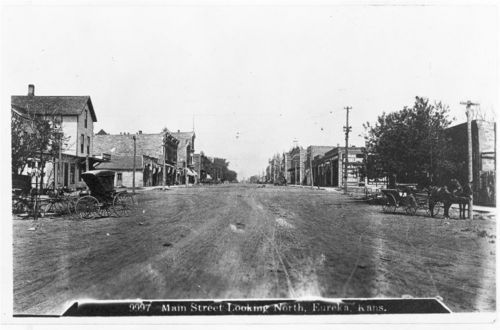 A view of a buggy and a wagon looking north on main street in Eureka, Kansas, 1887