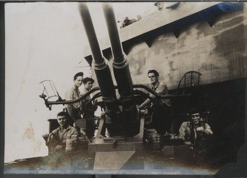 Sailors with the ship's guns on the USS Hopewell - Page