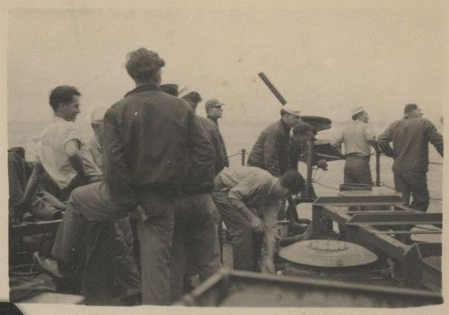 Sailors with a machine gun on the USS Hopewell - Page