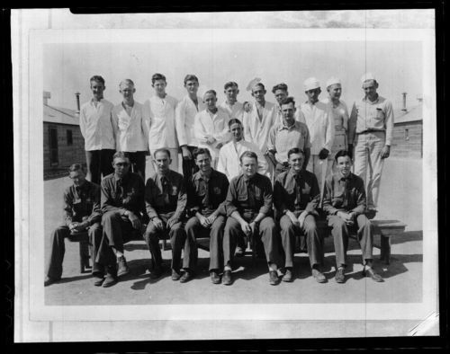 Photo of a group of uniformed young men from the Civilian Conservation Corps Camp in Kalvesta, 1934.