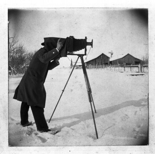 Sidney Wood photographing a farm, Chase County, Kansas - Page