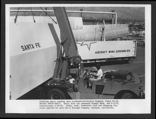 Loading airplane parts onto an Atchison, Topeka & Santa Fe Railway flat car - Page