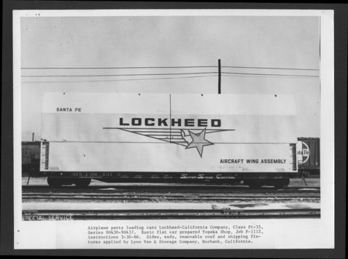 Airplane parts loaded on an Atchison, Topeka & Santa Fe Railway flat car - Page