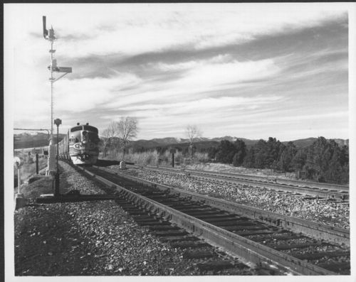 Atchison, Topeka & Santa Fe Railway's engine 21 pulling a passenger train - Page