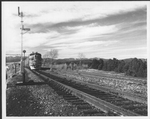 Atchison, Topeka & Santa Fe Railway's engine 21 pulling a passenger train - Page