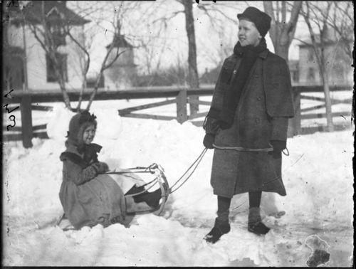 Children sledding in the snow, Russell, Kansas - Page
