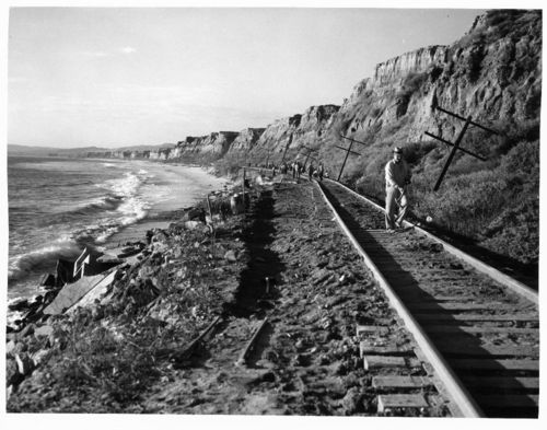 Repairing flood damage on the Atchison, Topeka & Santa Fe Railway's line between San Diego and Los Angeles, California - Page