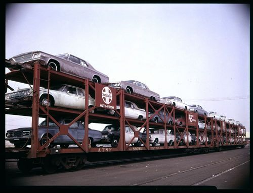 Atchison, Topeka & Santa Fe Railway Company's super shock control tri-level autoveyors - Page