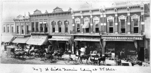 Drug stores on Main Street, Ottawa, Kansas - Page