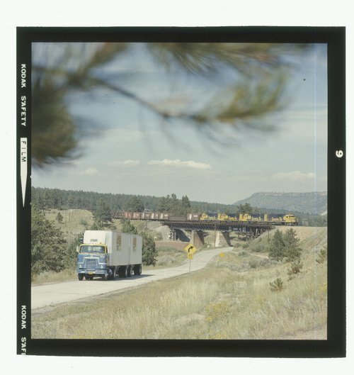 Atchison, Topeka & Santa Fe manifest freight train along with a Santa Fe truck - Page