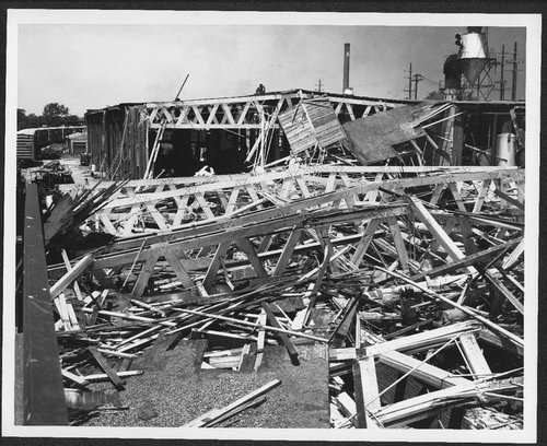 Atchison, Topeka and Santa Fe shop damage after a tornado strike, Topeka, Kansas - Page