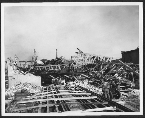 Atchison, Topeka and Santa Fe shop damage after tornado strike, Topeka, Kansas - Page