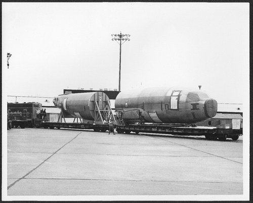Portion of the first Boeing 737 leaving Wichita, Kansas, pulled by Atchison Topeka & Santa Fe engine 2772. - Page