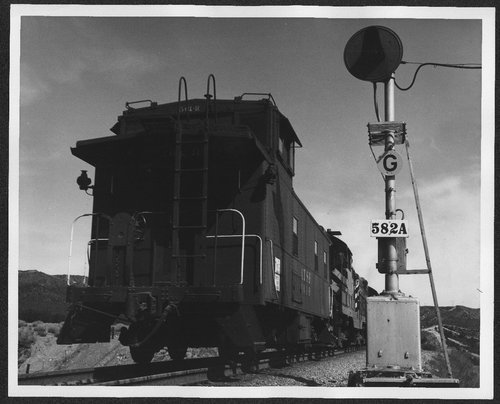 Atchison Topeka & Santa Fe  561-R passing grade signal 582A in Cajon Pass, California. - Page