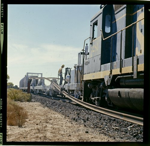 Atchison, Topeka & Santa Fe unloading welded rail (CWR) - Page