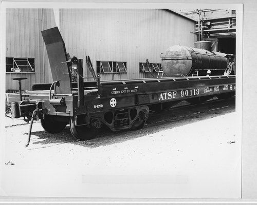 A trailer on an Atchison, Topeka, and Santa Fe flat car - Page