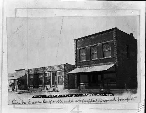 A photograph showing business buildings including the post office in Maple Hill, Kansas.