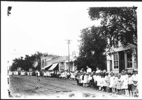 Adults and children gathered for a parade, Alma, Kansas - Page
