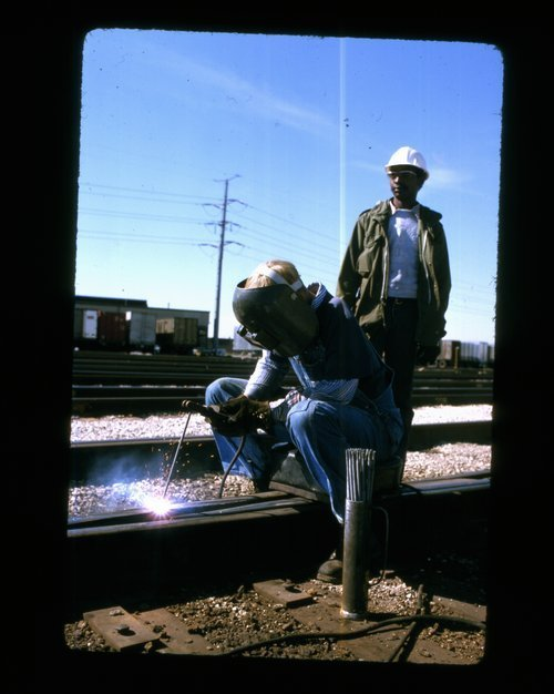 Atchison Topeka and Santa Fe welder working on the track - Page