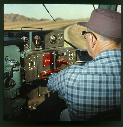 Atchison, Topeka & Santa Fe engineer a the control stand of a 1900 class locomotive - Page