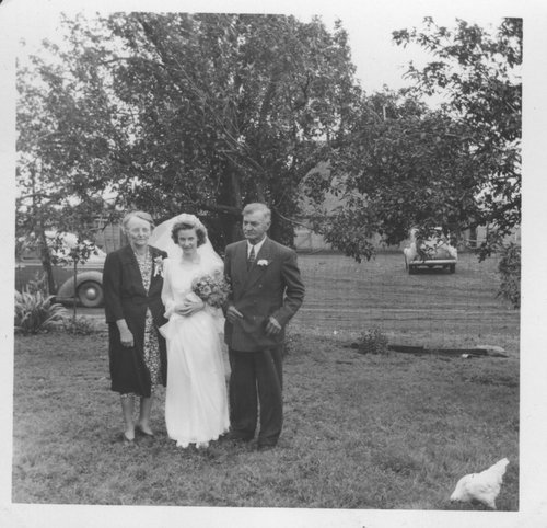 Louise Zeller DeDonder with her parents, Michael Louis and Mary Ottilia Meinhardt Zeller - Page