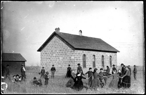Photograph showing children playing at Centennial School,  District #9, Montgomery County, Kansas, 1892