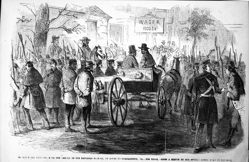 Carrying the prisoners from the armory to the railroad station, in route to Charlestown, Virginia,  for trial - Page