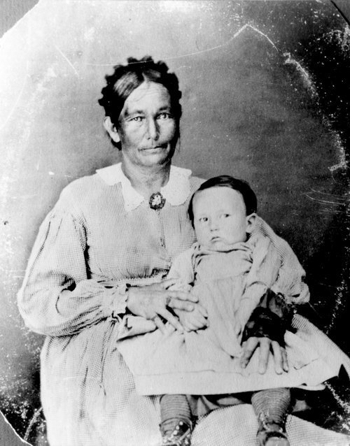 Photograph of Annie Grinter, a Delaware Indian, and her son  Cunningham, 1860s
