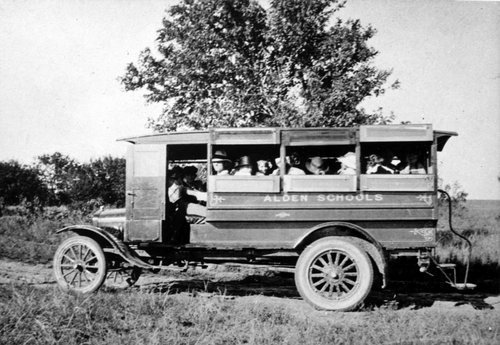 Photograph of first school bus purchased by Alden School (Rice