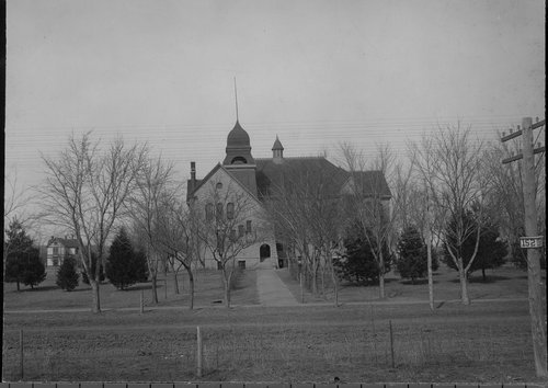 Photograph of the Dickinson County High School in Chapman, 1900s.