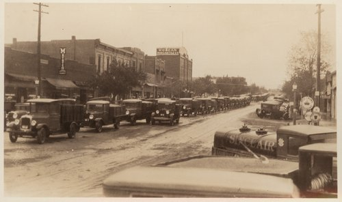 Grain trucks on Main Street, Cimarron, Kansas - Page