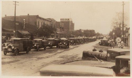Grain trucks on Main Street, Cimarron, Kansas - Page