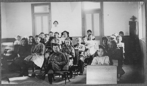 Children sitting at their desks, Cimarron, Kansas - Page