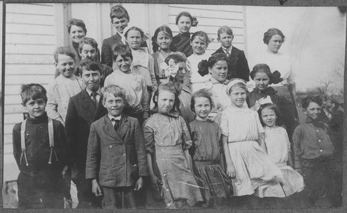 Students standing in front of school, Cimarron, Kansas - Page