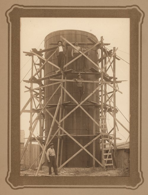 Photo of the construction of a silo east of Cimarron, Gray County, 1910s