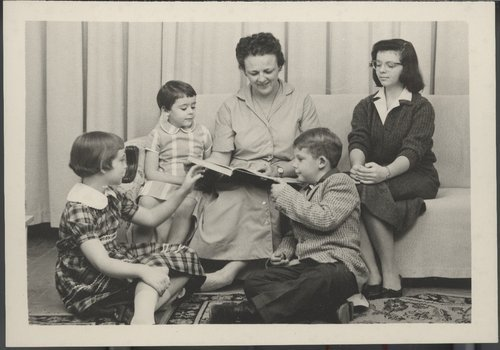 Myra Akin reading to her children, Cimarron, Kansas - Page