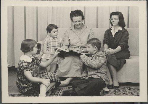 Myra Akin reading to her children, Cimarron, Kansas - Page