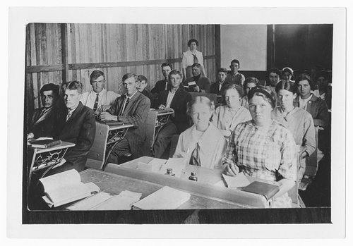 Photograph showing high school students seated at their desks in study hall, Cimarron, Kansas, 1920s