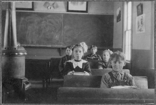 Children at their desks, Cimarron, Kansas - Page