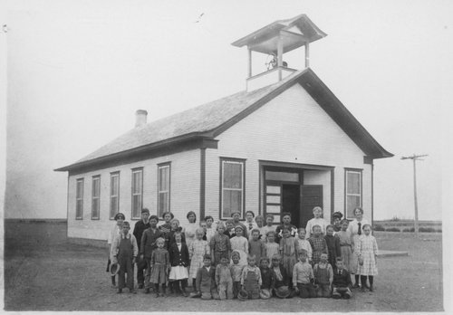 Photograph showing students posed in front of their rural school, Gray County, between 1905 and 1910