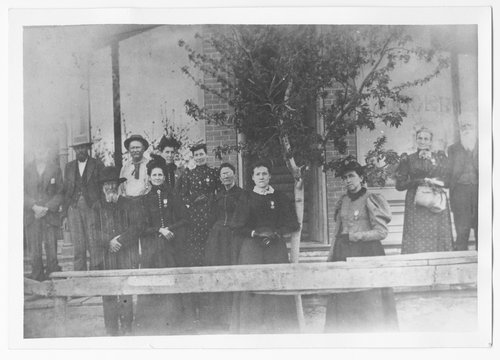People in front of a grocery store, Cimarron, Kansas - Page