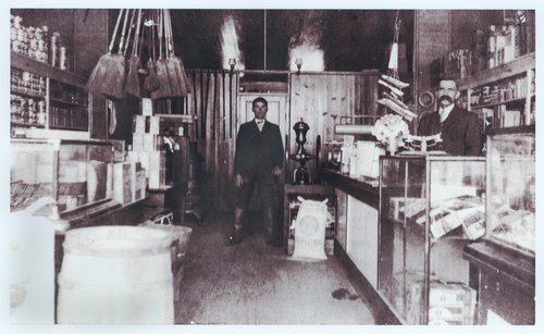 Photograph of the interior of Fisher's Grocery Store, south side of West Fourth Avenue, Caney, Kansas, 1880s.