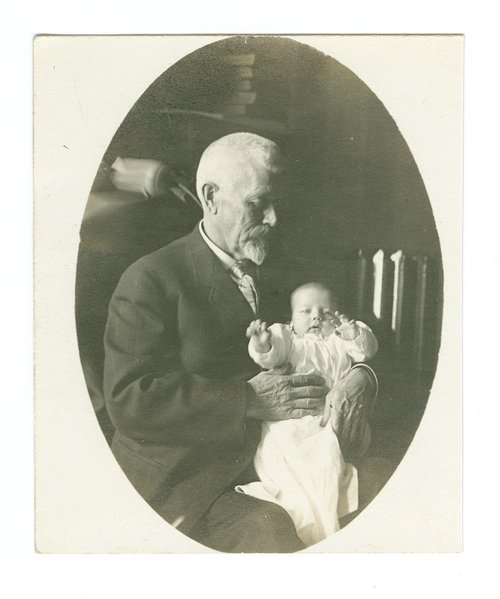 Cyrus Leland, Jr., holding baby - Page