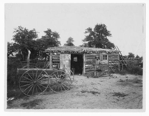 Log cabin near Kiowa, Kansas - Page