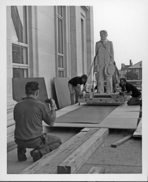 Photograph of the statue of Kansas Governor and U.S. Senator  Arthur Capper being moved into the Kansas Capitol, 1981.