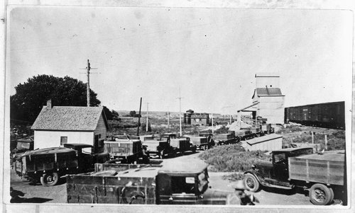 Trucks waiting at grain elevator, Sheridan County, Kansas - Page