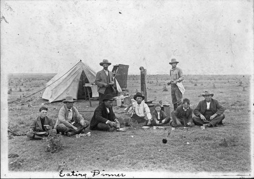 Round-up crew eating dinner, Clark County, Kansas - Page