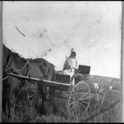 School teacher going to school, Finney County, Kansas - Page