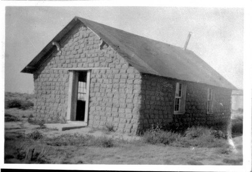Photograph of a sod school house called Solid Comfort, between 1880 and 1920